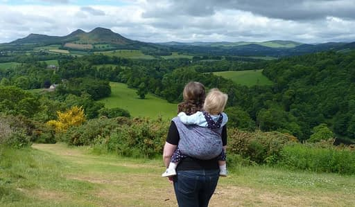 Carry Me Round sling walk with view of the Eilidons